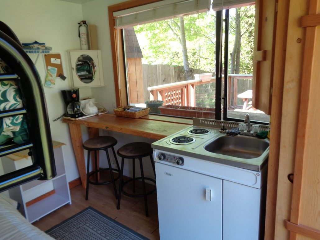 cabin kitchenette-there is a waterfront view from the window